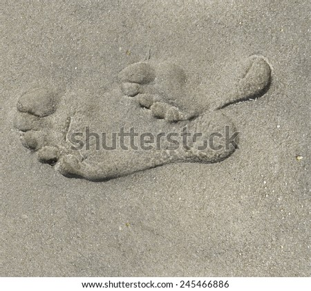 Togetherness Child and Parent Foot Print in Sand at the Beach - stock photo