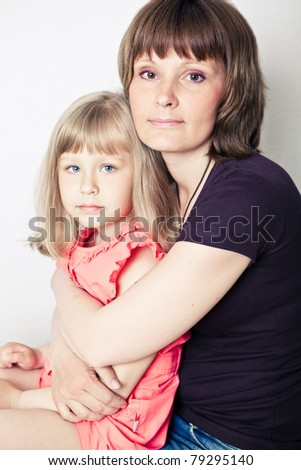 Togetherness of young beautiful woman with little daughter