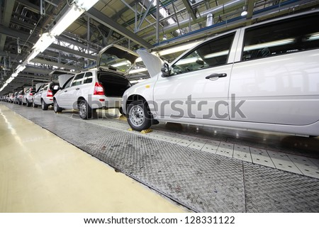 TOGLIATTI - SEPTEMBER 30: Lada Kalina cars on line on factory VAZ on September 30, 2011 in Togliatti, Russia. VAZ plans to start production of SUV Lada Kalina. - stock photo