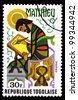 TOGO - CIRCA 1978: A post stamp printed in the Republic of Togo shows Matthew the Evangelist, circa 1978 - stock