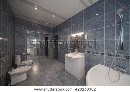 Toilet and bathroom in a modern home.