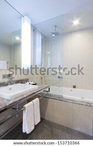 toilet and bathroom with rain shower head. - stock photo