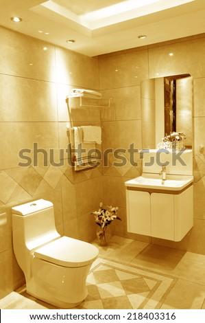 toilet and bathroom with rain shower head - stock photo