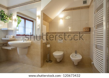 Toilet and bidet in a creamy new bathroom