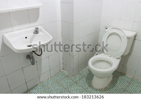 toilet and white tile in home