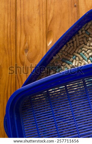 Toilet container for the cat out of the blue plastic. - stock photo
