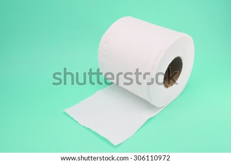 Toilet paper on color background
