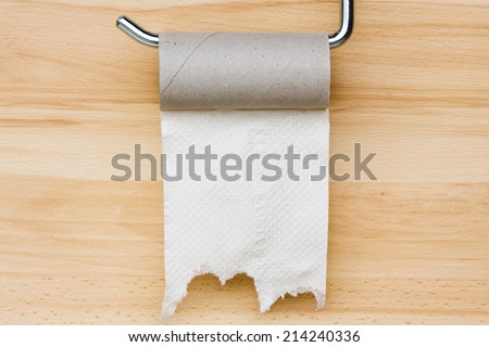 Toilet paper on wooden background. Empty space for text - stock photo