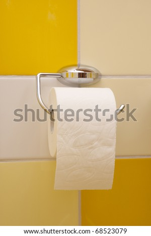 toilet paper roll hanging - stock photo