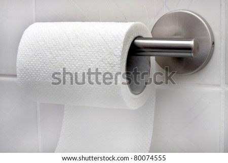toilet paper roll in bathroom - stock photo