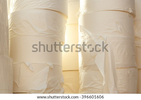 Toilet paper rolls in closeup as background - stock photo