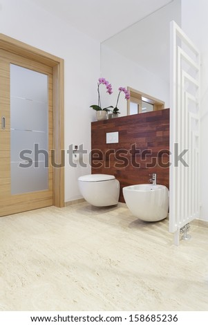 Toilet room in house with exotic wood