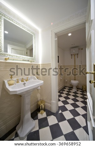 Toilet room in old style. - stock photo