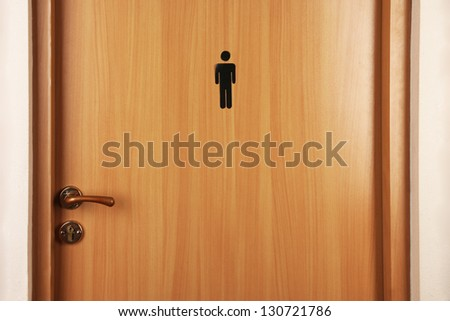 Toilet sign on wooden door - stock photo