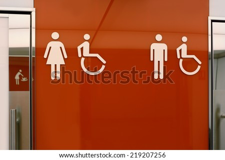 toilet signs of men woman man handicapped and baby change  - stock photo