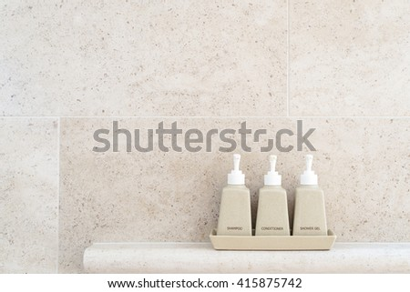 Toiletries tube in a luxury hotel, shower gel, shampoo and hair conditioner in ceramic ware. Copy space. - stock photo