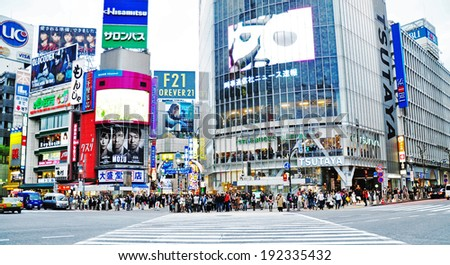 TOKYO - APRIL 04: Crowds of people crossing the center of Shibuya on April 04, 2014. The most important commercial center in Tokyo, Japan. - stock photo