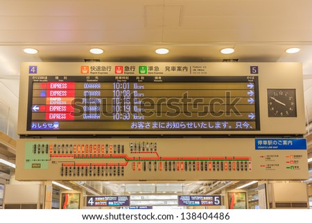 TOKYO - APRIL 9 : Electronic Train schedule board at  Shinjuku station, Tokyo on April 9, 12. With more than 1.5 million passengers per day, Shinjuku is the biggest station in the world. - stock photo