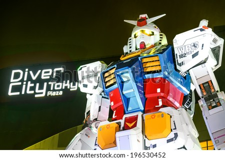 "TOKYO - 21 April 2014: The 1:1 scale mobile suit Gundam RX78-2 which is 18 metres high from ""Mobile Suit Gundam"" anime series. Is located in Odaiba in front of the ""Diver City"". - stock photo"