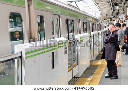 TOKYO - APRIL1, 2016: The Yamanote Line (Yamanote-sen) is Tokyo's most important train line,People waiting for rail train at Tokyo main railway station in April 1, 2016 Tokyo, Japan. - stock photo