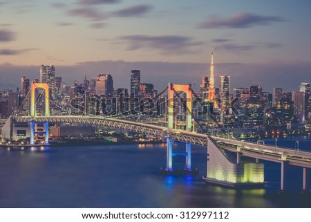 Tokyo bay and Tokyo rainbow bridge in evening - stock photo