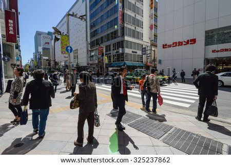 TOKYO - CIRCA APRIL 2013: people on the street in Shinjuku district of Tokyo, Japan circa April 2013.  - stock photo
