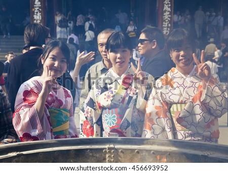 TOKYO - CIRCA JUNE, 2016: Japsnese teenage girls in kimonos at Sensoji-ji Red Japanese Temple in Asakusa, Tokyo, Japan  - stock photo