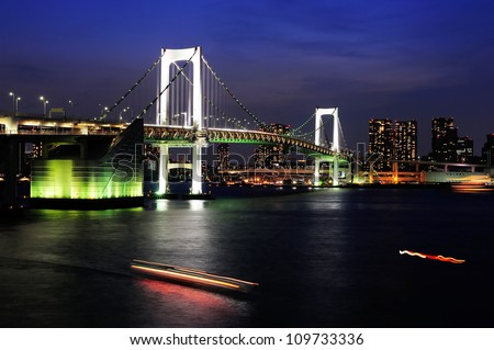 Tokyo city and rainbow bridge in twilight - stock photo