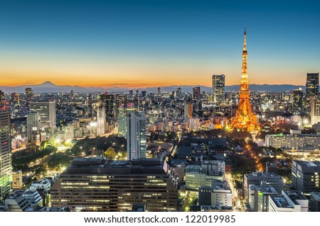 Tokyo city at twilight with Mt Fuji on the background