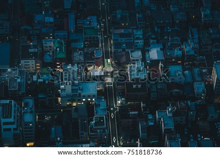 Tokyo city streets at night as seen from above aerial photography