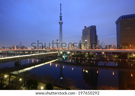 Tokyo city view and peaceful reflection at dawn - stock photo