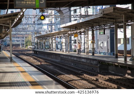 TOKYO, JAPAN - APR 12 : Hamamatsucho station on Yamanote line on April 12, 2016. at Tokyo, Japan. Tourists from Haneda airport can change train this station to Tokyo or another city in Japan. - stock photo
