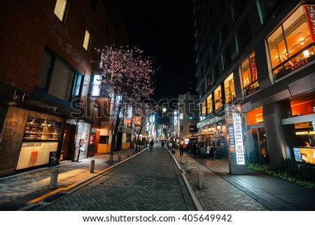TOKYO, JAPAN - Apr 06, 2016: The streets and night lights of Tokyo. Tokyo - Japans capital, administrative, financial, cultural, commercial and political center. The largest city economy in the world - stock photo