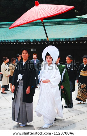 TOKYO,JAPAN-APRIL 2:A Japanese wedding ceremony at Shrine on April 2,2010.As Meiji Jingu Shrine is an active shrine it's possible to see wedding parties parading through the inner ground of the shrine - stock photo