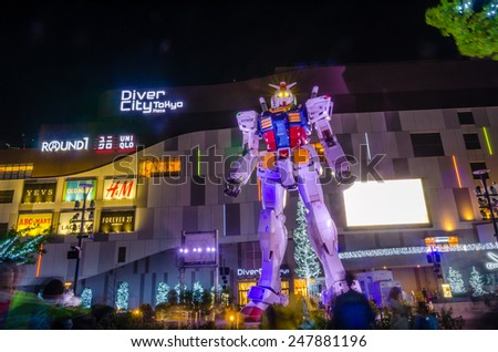 "TOKYO,JAPAN - 27 April,2014 :  A ""life sized"" Gundam statue stands in front of DiverCity Tokyo Plaza , the shopping, dining and entertainment complex opened in 2012."
