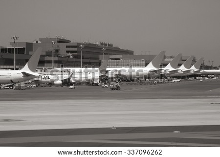 TOKYO, JAPAN - APRIL 12, 2012: Passengers board Japan Airlines aircraft at Narita International Airport, Tokyo. In the fiscal year ended March 31, 2009 JAL group carried over 52 million passengers.