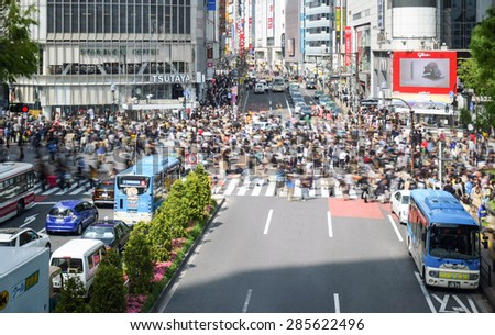 Tokyo, Japan - April 18, 2015: Pedestrians walk at Shibuya Crossing. Shibuya is a popular disctict in Tokyko with fashionable brands. This is a very busy district. - stock photo