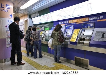 TOKYO, JAPAN - APRIL 13, 2012: People buy tickets for Toei Metro in Tokyo. With more than 3.1 billion annual passenger rides, Tokyo subway system is the busiest worldwide.