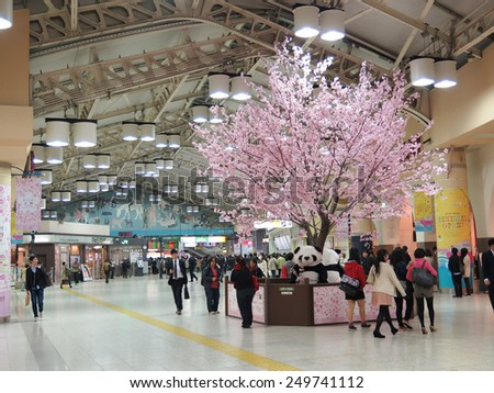 TOKYO, JAPAN - APRIL 8 : Sakura tree inside Ueno station in spring season taken April 8, 2014 in Tokyo. Ueno is one of busiest station hub in Tokyo which close to Ueno zoo and park.  - stock photo