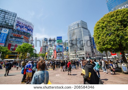 TOKYO, JAPAN - APRIL 15: Shibuya crossing in Tokyo, Japan on April 15, 2014. The most popular shopping city in Japan - stock photo