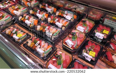 TOKYO, JAPAN - APRIL 21 : Sushi packs in Japanese supermarket taken April 2014, 21 in Tokyo. Variety of sushi on shelves in supermarket in Japan. - stock photo