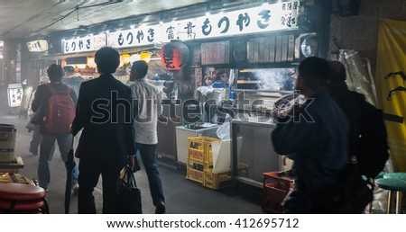 TOKYO, JAPAN - APRIL 28TH, 2016: Small Japanese restaurants at the Yurakucho Alley under elevated Japan Railway rail tracks..