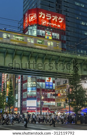 TOKYO, JAPAN - AUGUST Evening rush hour traffic in Akihabara with the bright neon advertisements in the background shown on August 7, 2015 in Tokyo, Japan