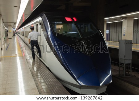 TOKYO, JAPAN - AUGUST 24: Keisei Skyliner waits for passengers at Ueno terminal on August 24, 2012. It is one of the fastest railway trains to get Narita Airport reaching speed of 160 km/h. - stock photo