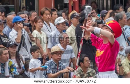 TOKYO, JAPAN - AUGUST 26TH, 2017. Japanese children school band at the Asakusa Samba Carnival Parade in Tokyo.