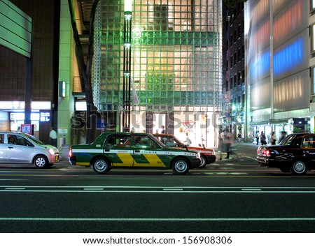 TOKYO, JAPAN- AUGUST 21, 2013: Traffic in Ginza area, which contained with numerous department store, boutique, art gallery, restaurant, night club and cafe. Tokyo, Japan. August 21 2013
