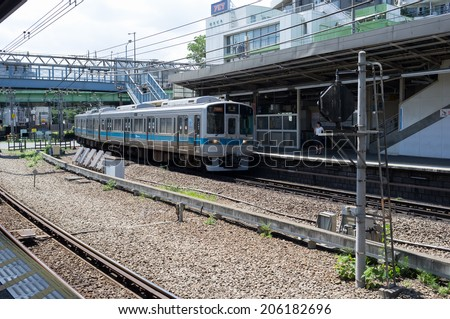 TOKYO, JAPAN - CIRCA JULY, 2014: JR Commutor trains are the main mode of transportation in Tokyo. JR is owned by the government of tokyo. - stock photo