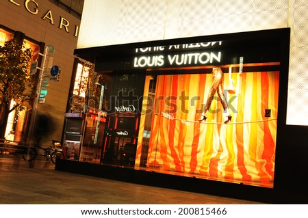 TOKYO, JAPAN - DECEMBER 28, 2011: ight view of luxurious Louis Vuitton shop in Ginza, Tokyo - stock photo