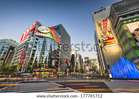 TOKYO, JAPAN - DECEMBER 25, 2012: Sukiyabashi Crossing at the Ginza. Ginza extends for 2.4 km and is one of the world's premiere shopping districts. - stock photo