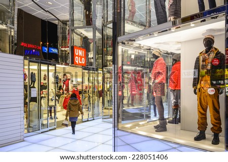 TOKYO, JAPAN - DECEMBER 29, 2012: UNIQLO clothing store in Tokyo. The fashion retailer is headquartered in Tokyo with hundreds of store locations in over a dozen countries. - stock photo